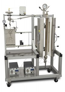Up-flow 5403 Tubular Reactor System with 300 mL heated volume, one purge line, one gas feed, two liquid feeds, product cooling condenser, and automated 2-phase back pressure regulator. An automated liquid sampler captures representative samples at a user-programmable interval.